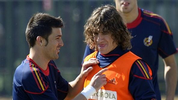 David Villa y Carles Puyol