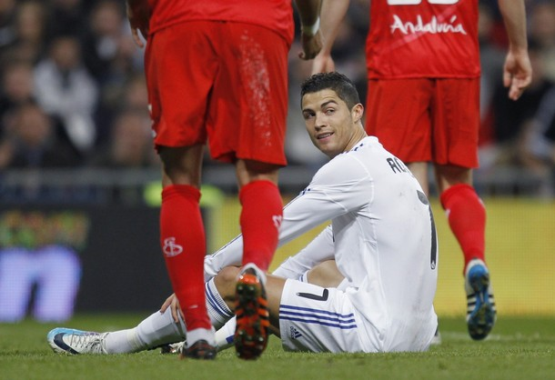 Real Madrid's Cristiano Ronaldo sits on the pitch during the Spanish King's Cup semi-final second leg soccer match against Sevilla in Madrid